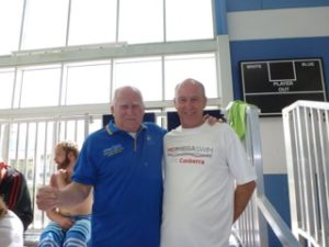This image shows President John Collis (left) models his one million metres polo shirt, while Ross Burden (right) advertises the MS 24 hour Mega Swim
