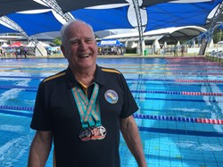 John Collis displays his medals at Tobruk Pool, Cairns, 2021